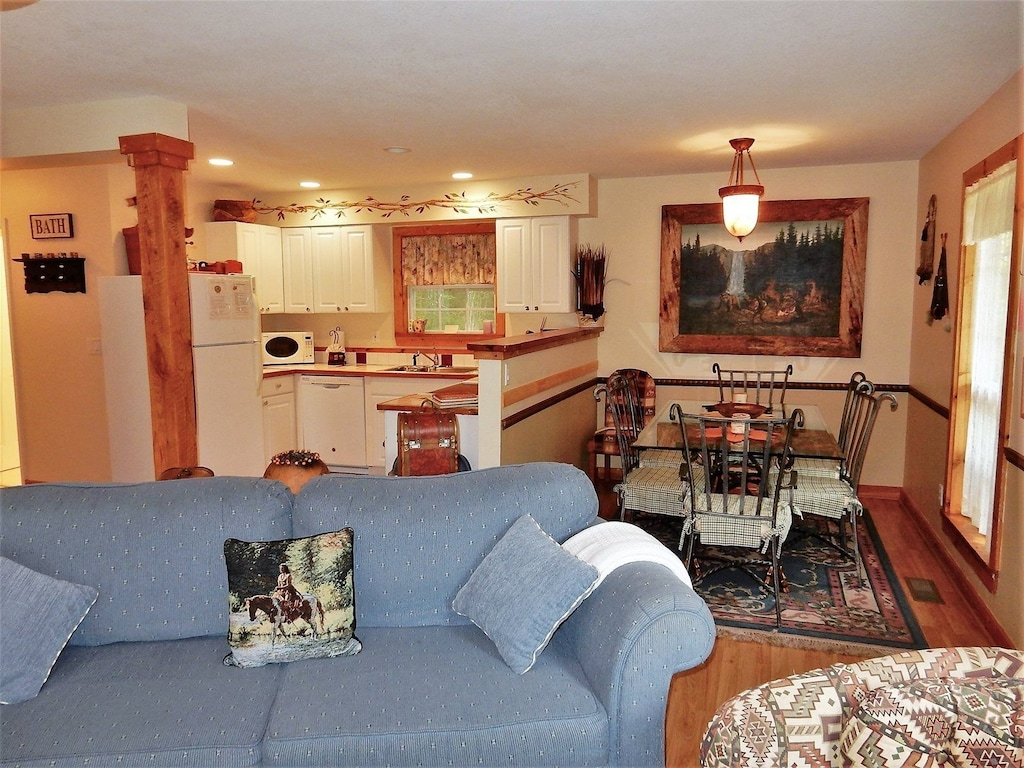 View of living room area and dining area