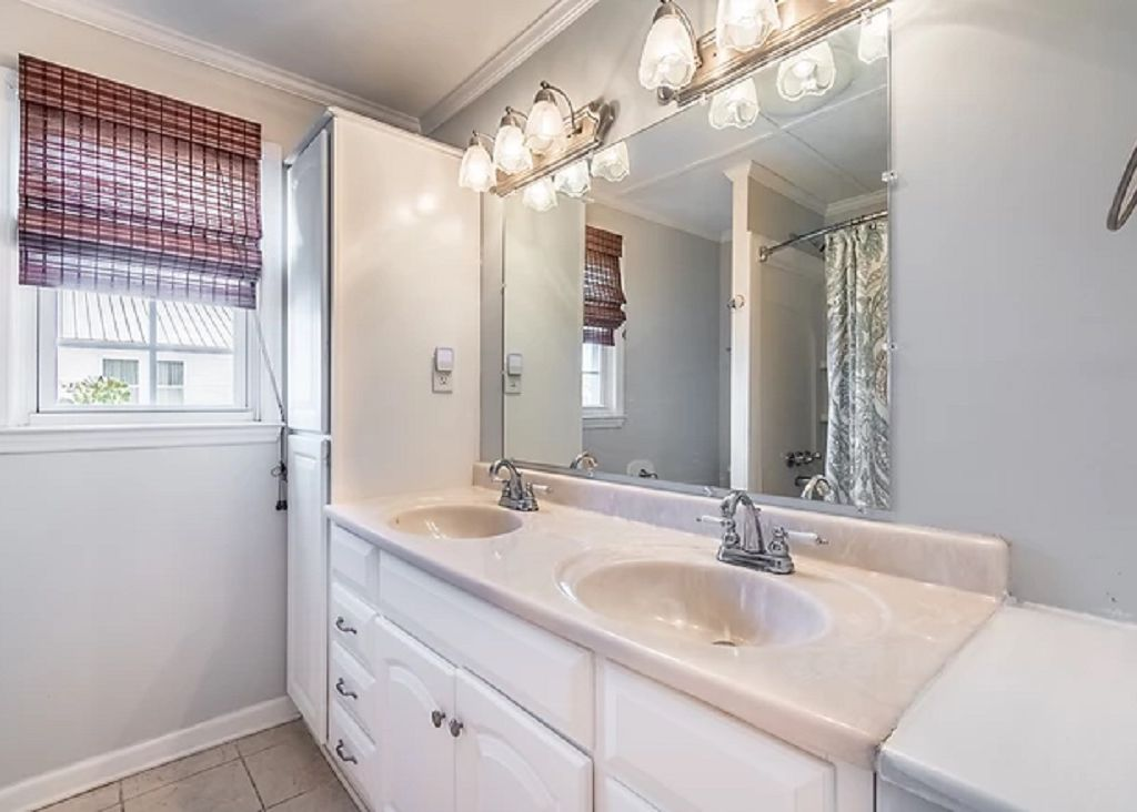 Full bath with double vanities! Between the master and gb 2