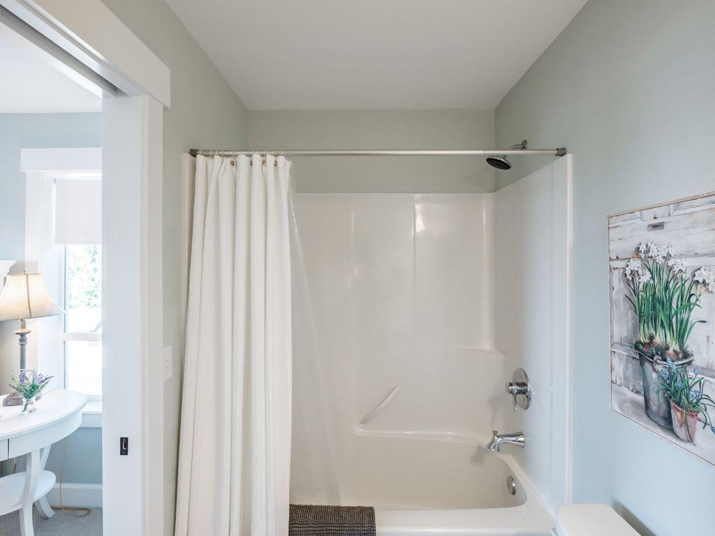Jack and Jill bathroom is shared between queen bedroom and bunk room.