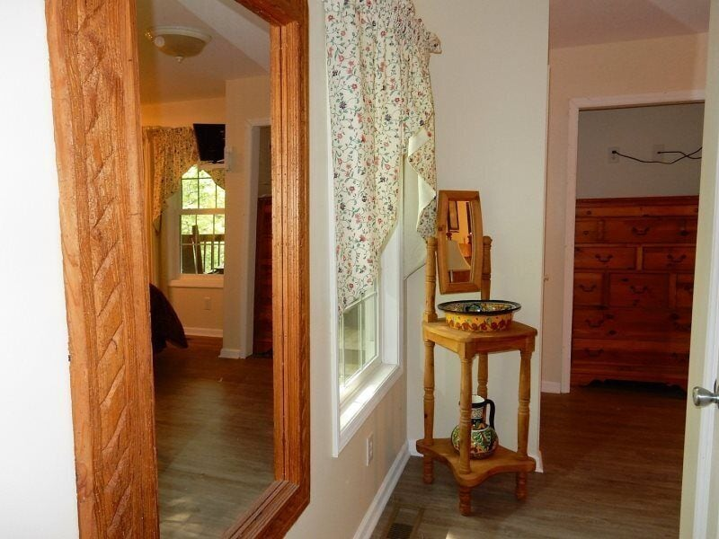 This hall from the master bedroom leads to the bathroom.