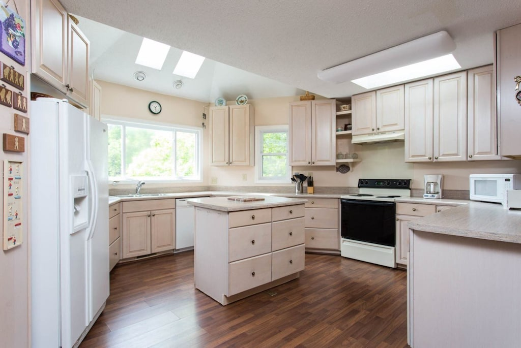 The spacious kitchen is fully equipped with all of the conveniences of home.