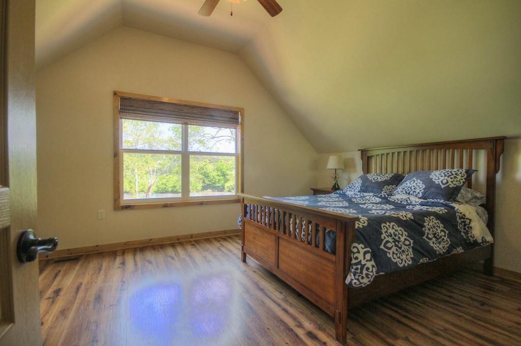 Biggest master bedroom queen bed overlooking yard and river