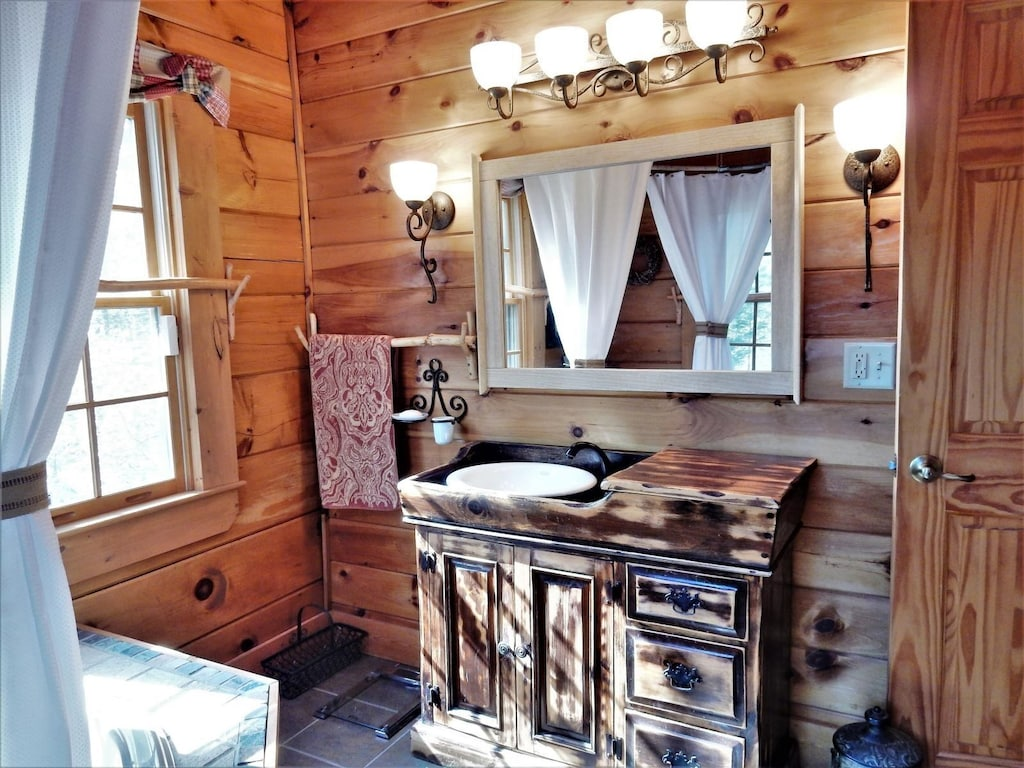 The master bathroom has comfortable and romantic touches throughout.