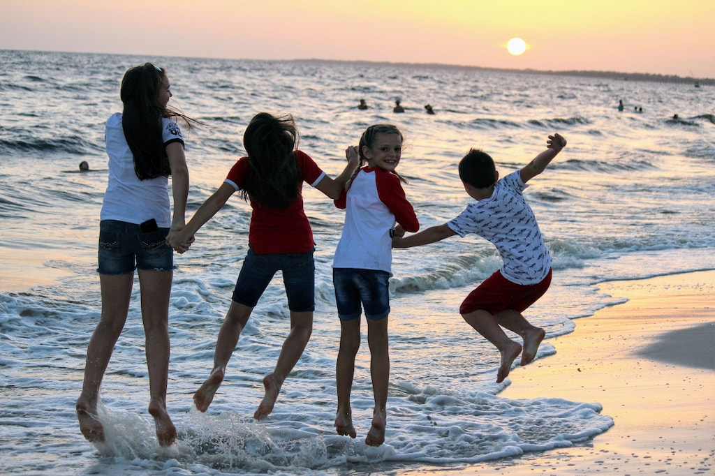 Jump for joy at the water's edge in Mexico Beach.