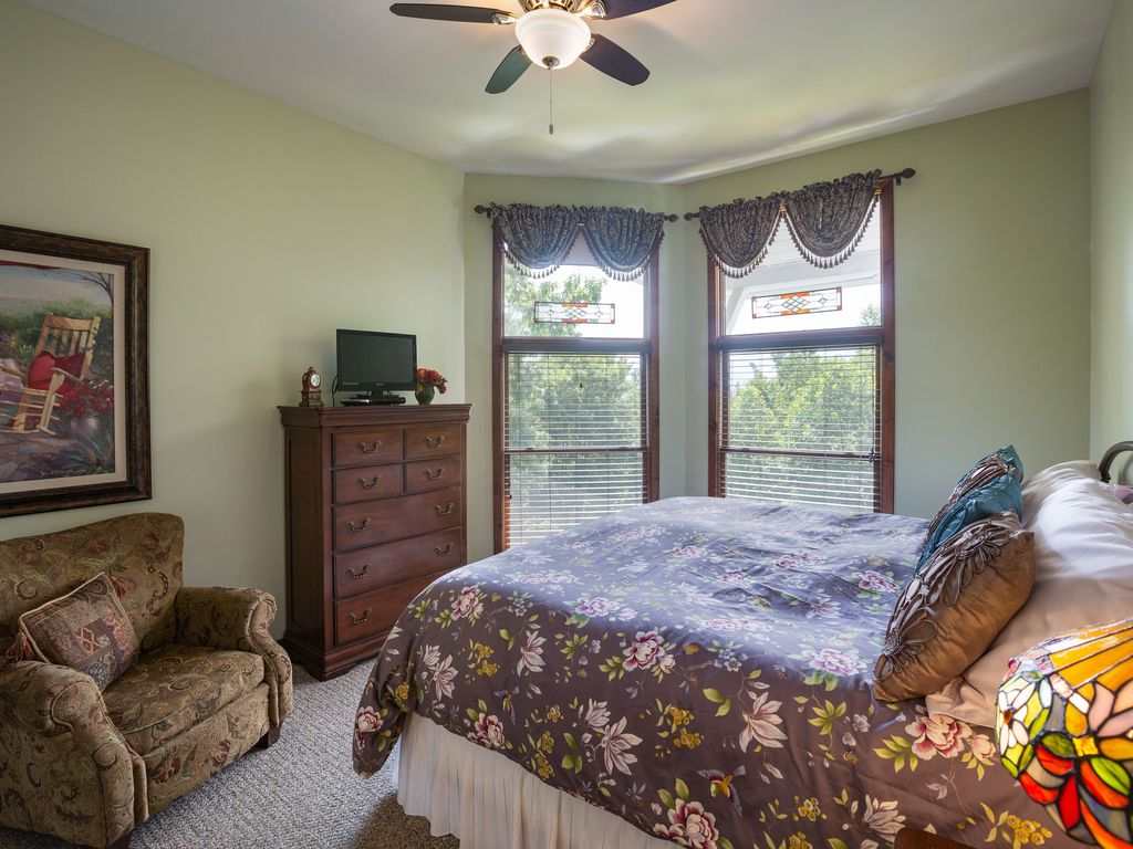 2nd floor king suite with TV, private bath, closet, mountain view.