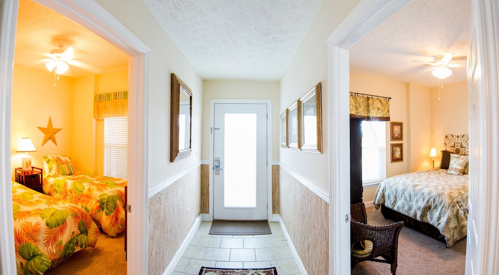 The second and third bedrooms in this Mexico Beach beauty are elegant and fun!