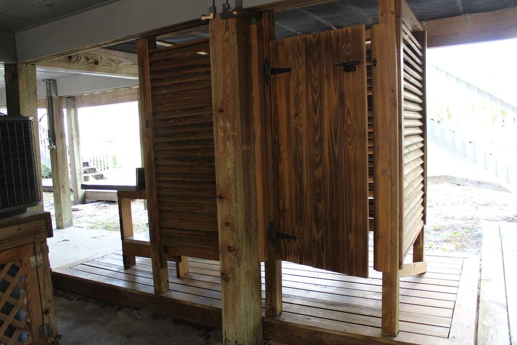 Outdoor shower located in carport.