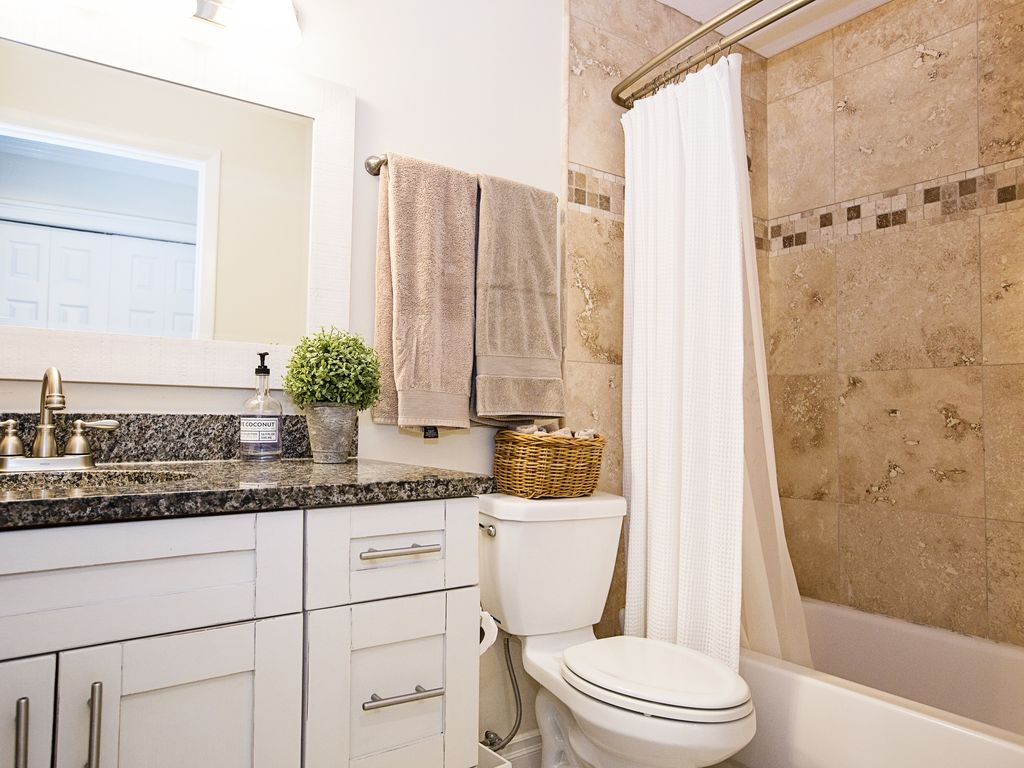 newly renovated guest bathroom with a bathtub and shower.
