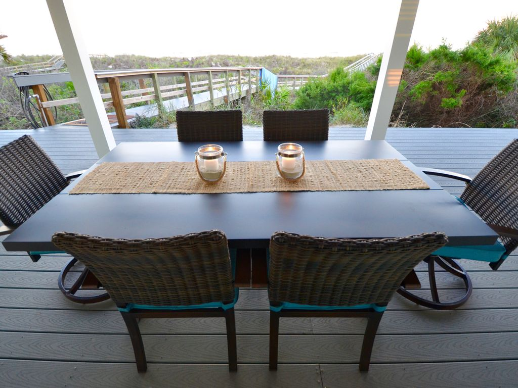 Dine al fresco on the back porch overlooking the ocean.