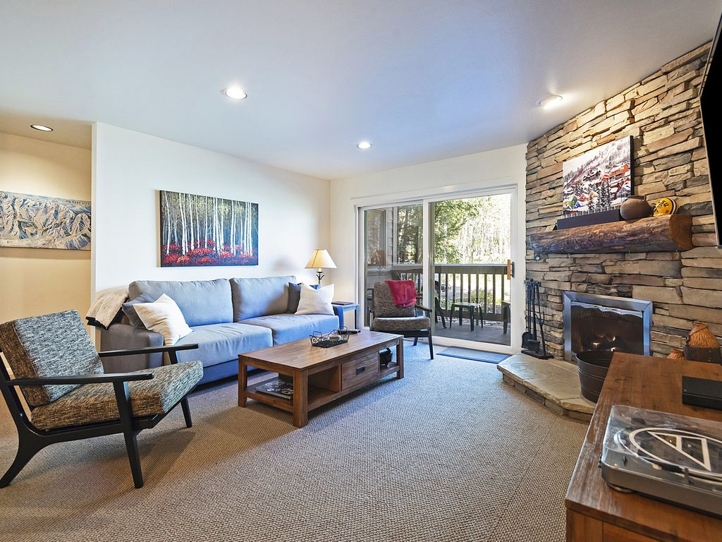 """Open living area with wood burning fireplace, 72"""" flatscreen, private deck"""
