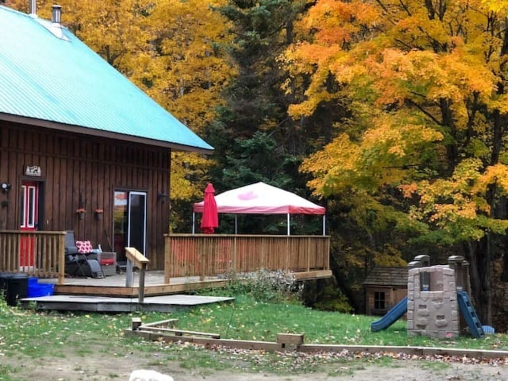 The cottage is getting surrounded by the beautiful Fall colors