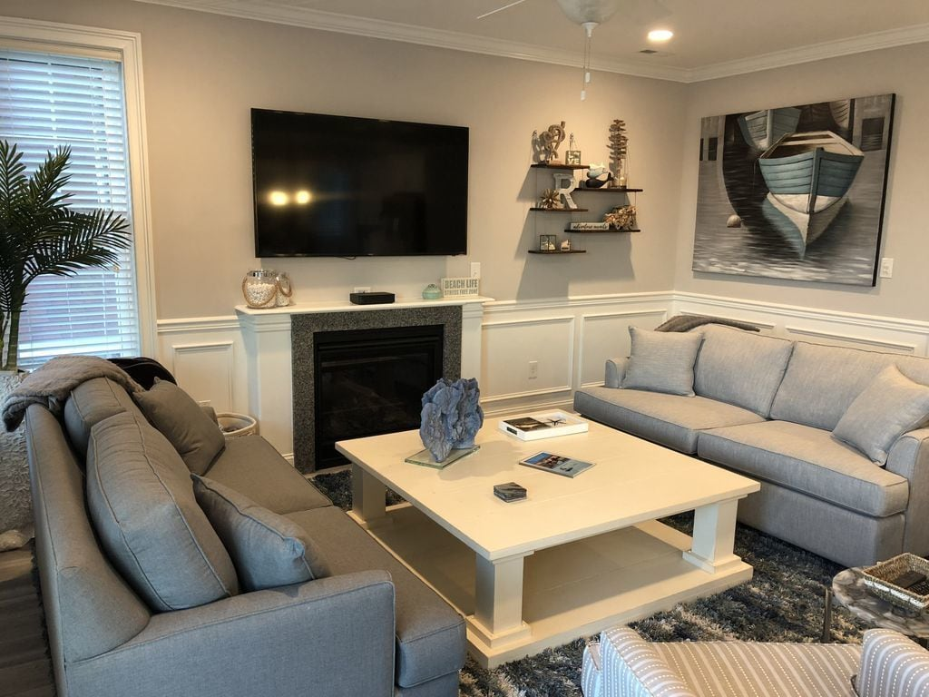 Open Family / Living Area with sleeper sofa and Samsung 65 inch 4K TV