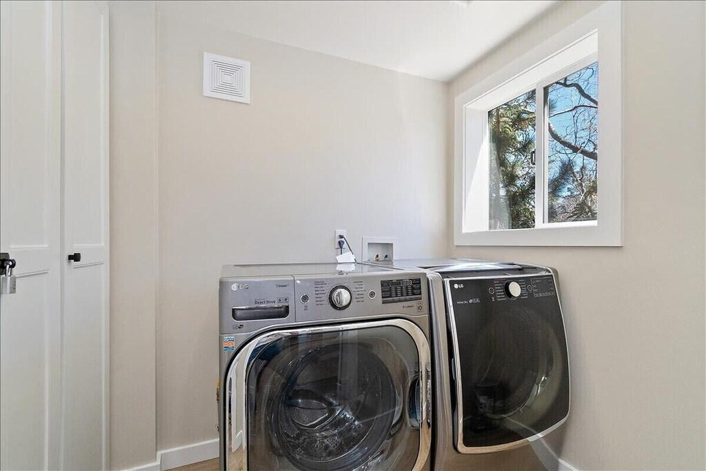 Fully stocked Laundry room with brand new appliances.