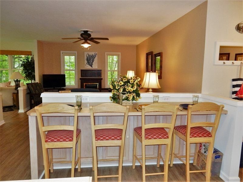 Additional seating for 4 across from the kitchen overlooks the living area.