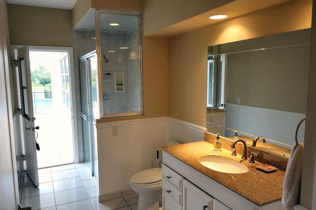 Cabana bathroom - full bathroom that can be accessed from inside door or outside pool area