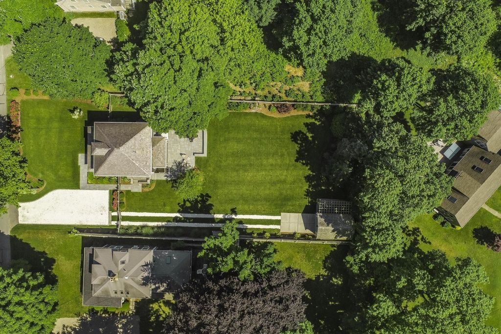 Spacious and impeccably landscaped yard for private gatherings and yard games.