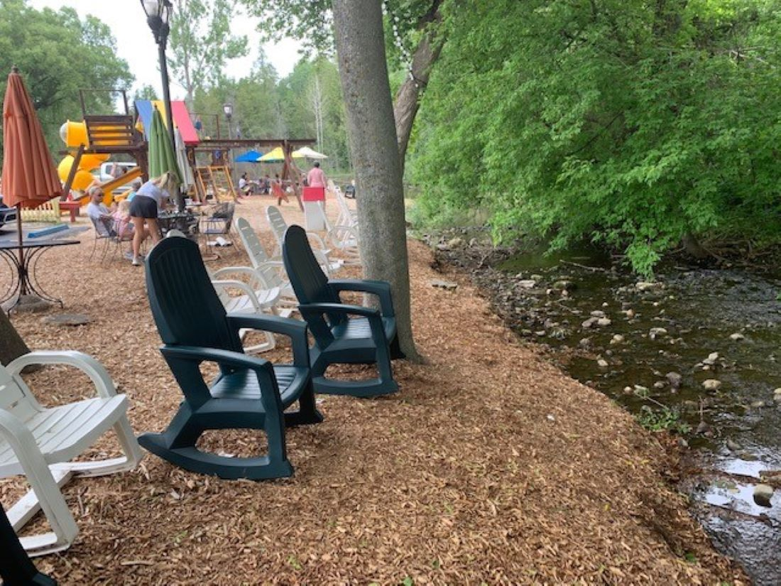 Not Licked Yet is across the street and has a great free playground, seating, and river to explore in.