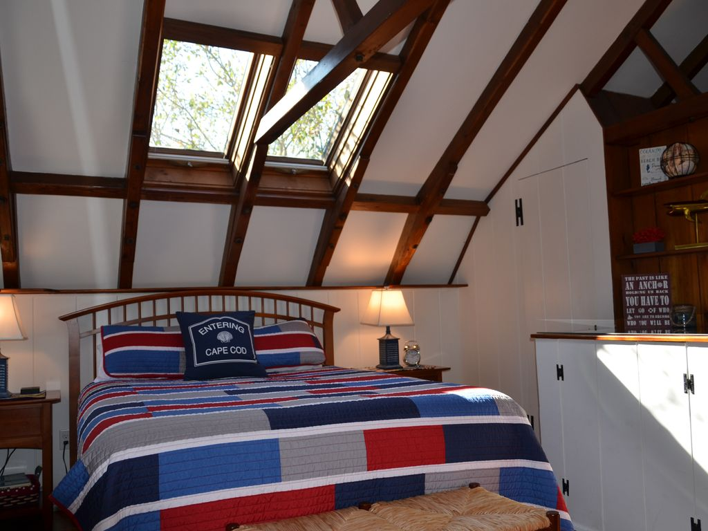 2nd Floor Master Bedroom ensuite with queen bed and numerous skylights.