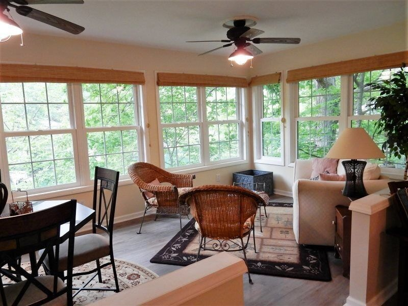 Windows run along with entire back and side walls of the home providing wonderful views of the lake and scenery.