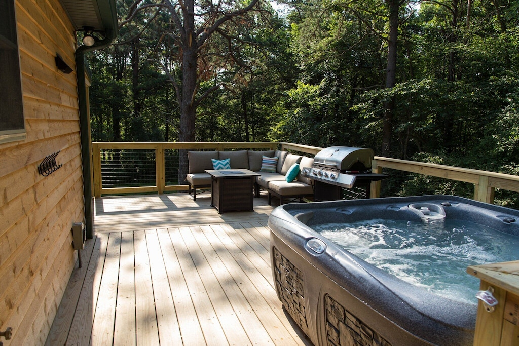 Spacious deck with gas grill, new hot tub and sitting area