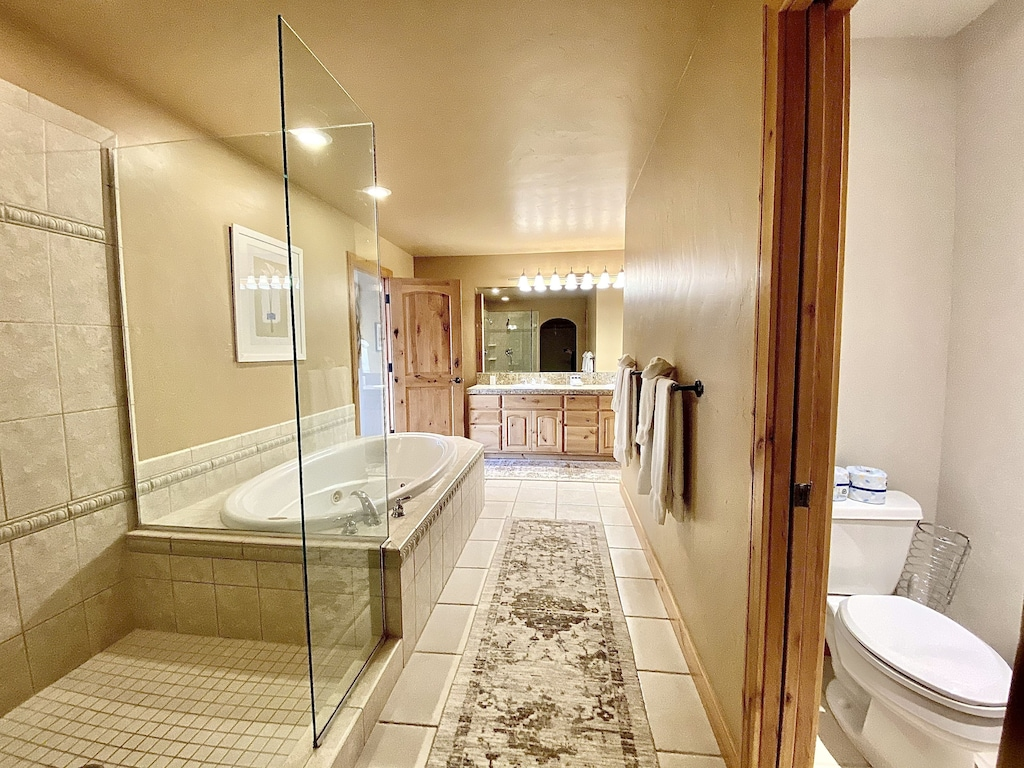 Bedroom 3 bath - Private bath for bedroom 3 with walk in shower, jetted tub and double sinks.