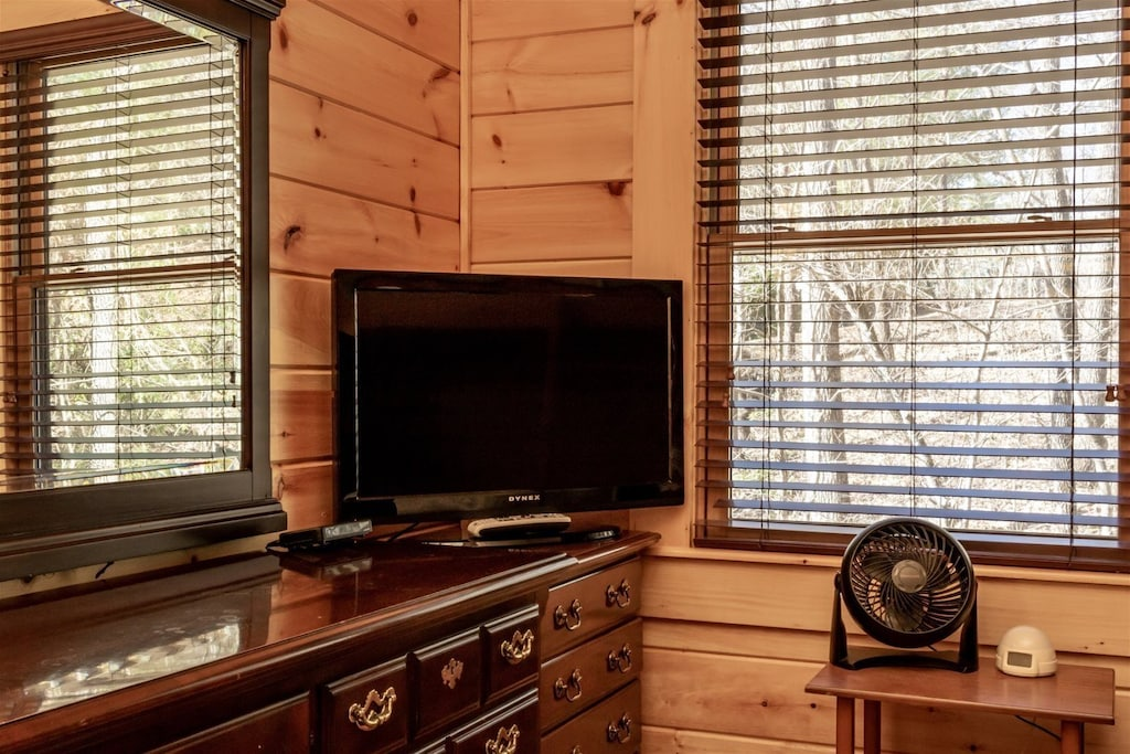 TV and plenty of storage in this bedroom.