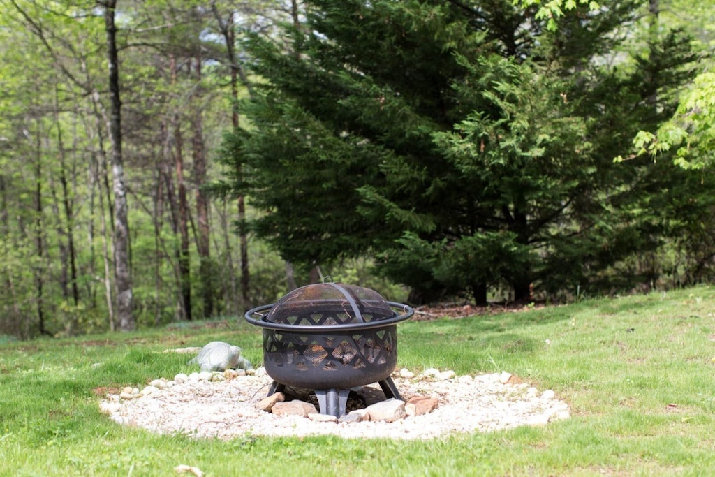 Covered fire pit for guest use.