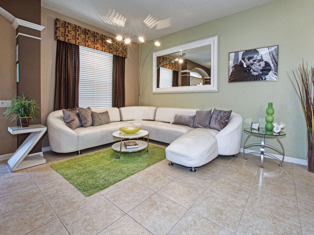 Front living room provides a nice place for conversation or gathering kids.