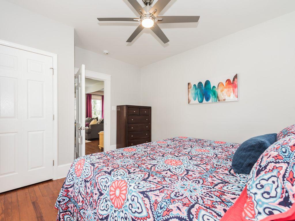 King Bed, dresser, closet, duel remote light/fan, blinds & blackout curtains.
