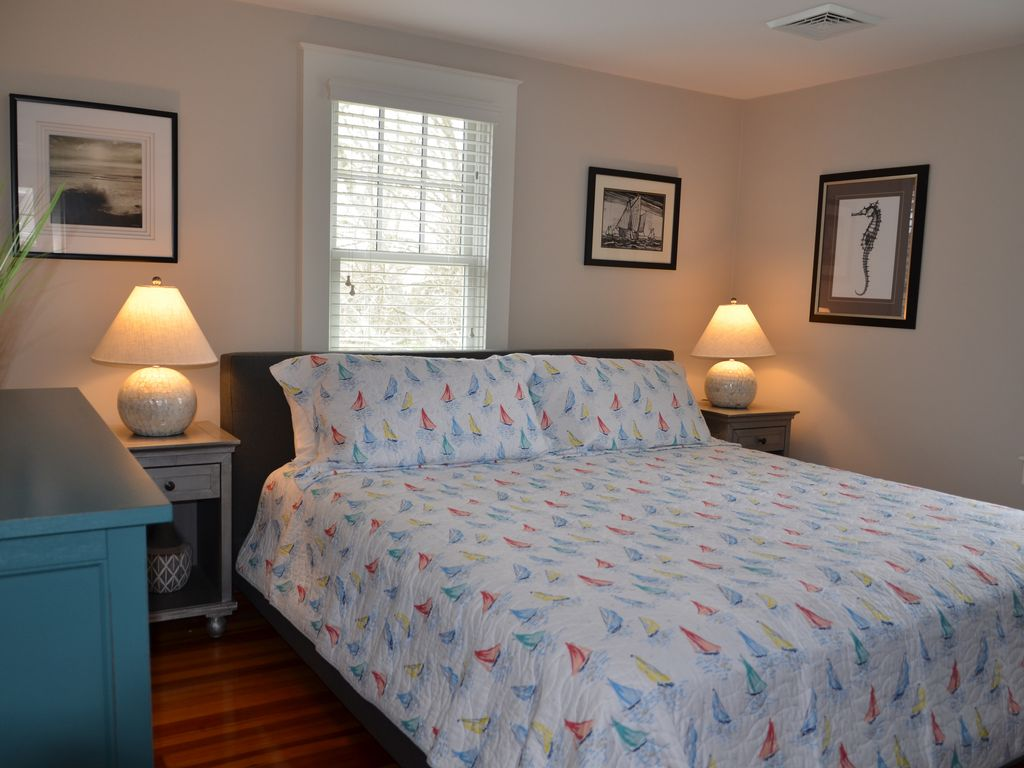 Newly furnished master bedroom with king size bed.
