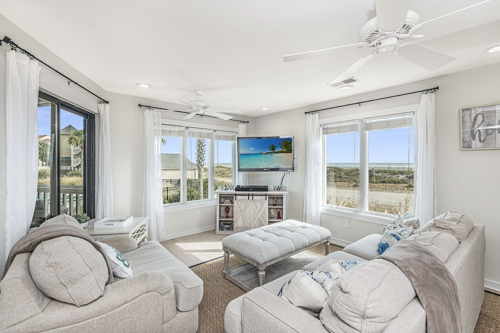Living room with panoramic beach and pool views