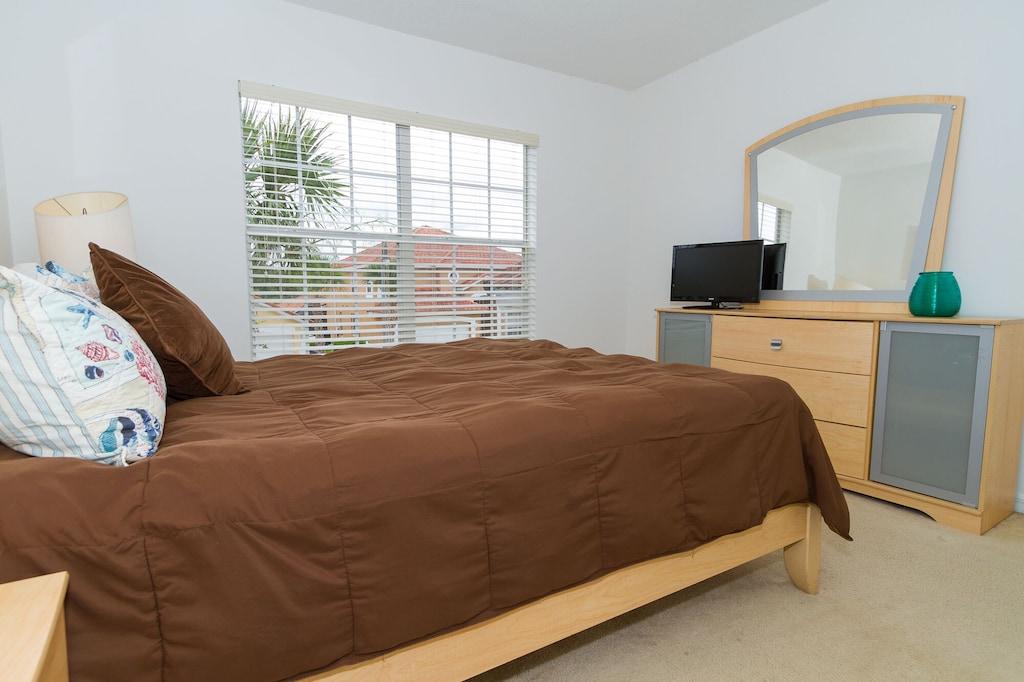 Upstairs queen bedroom with TV