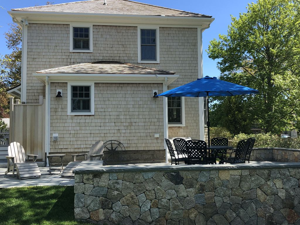 Spacious patio with new 3 burner Weber gas grill, adirondacks and patio table.
