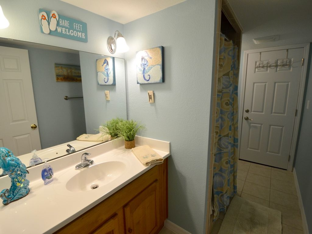 Hall bath with walk in shower, access to porch--no need to walk thru living room