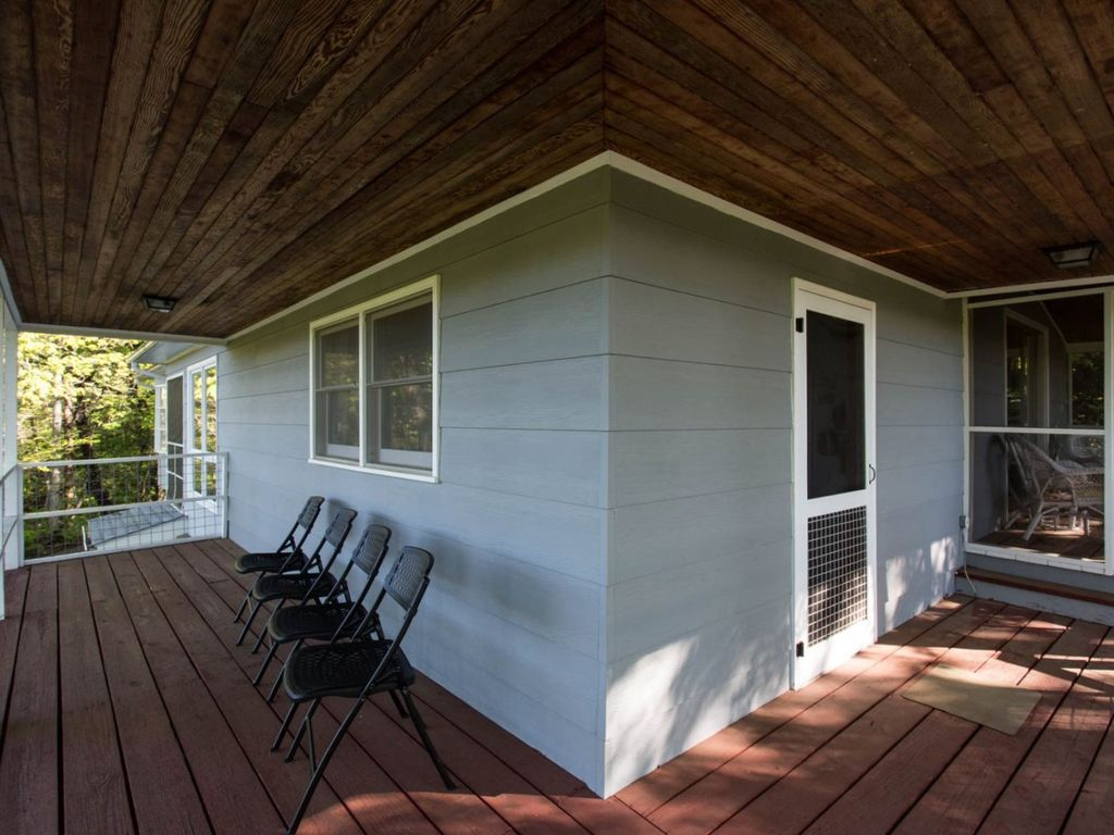 The home boasts a deck and two screen porches.