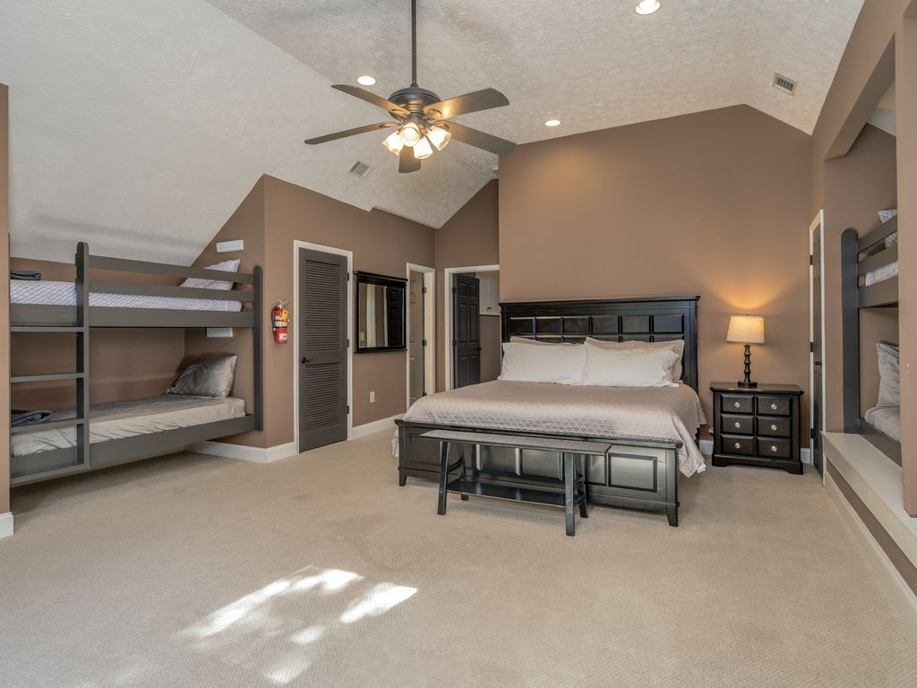 Bunk room with king bed