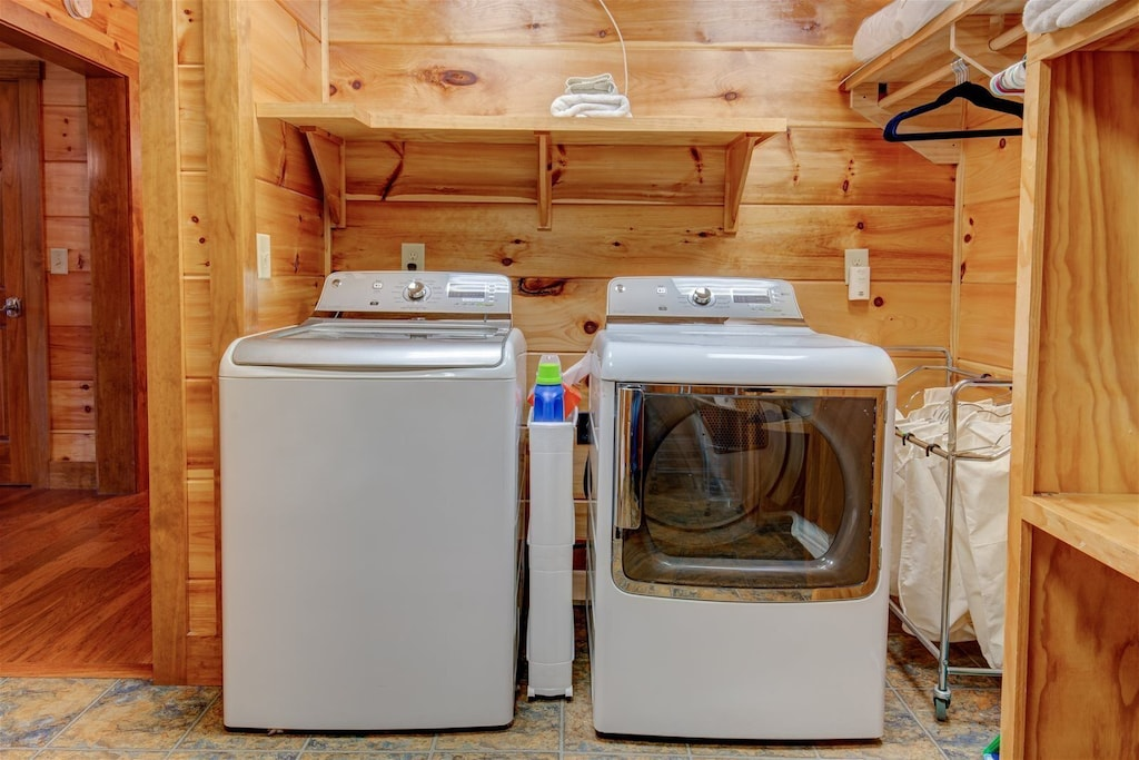 Large laundry room in lower level with super size washer and dryer
