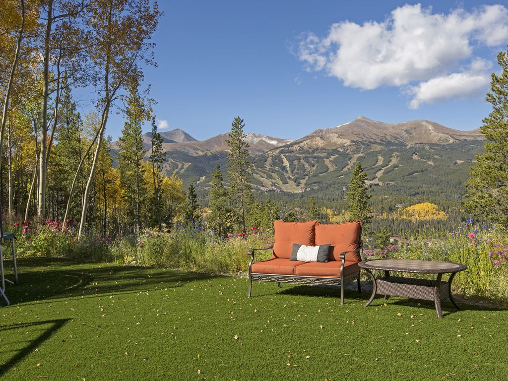 A sanctuary in the yard - Artificial turf.  Looks perfect all the time!