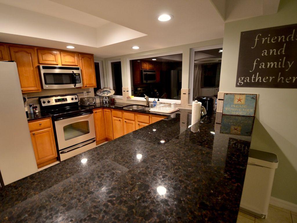 Plenty of preparation space on the black granite counters.