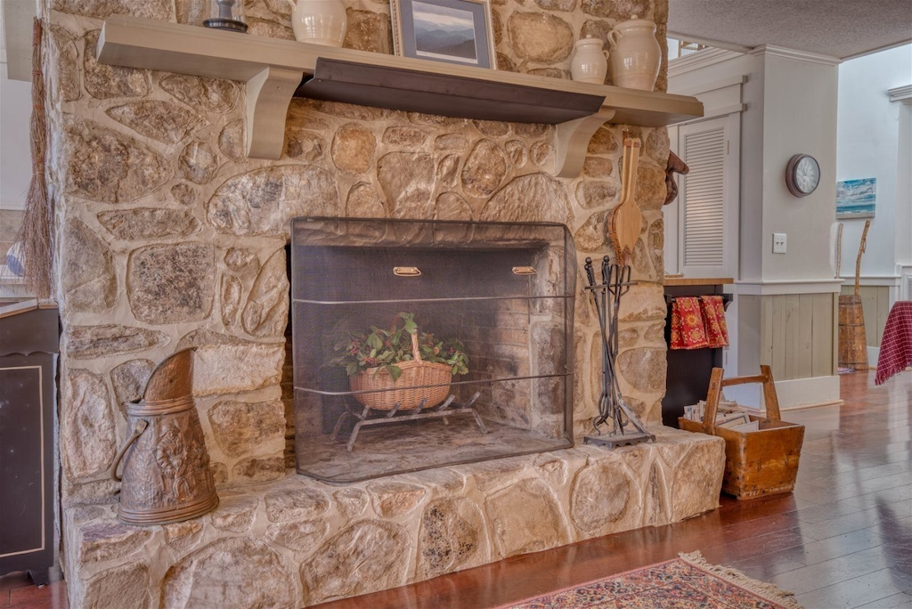 Handsome stone fireplace is non operational at this time