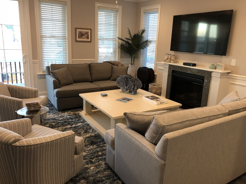 Features 2 swivel chairs and oversized coffee table for your comfort