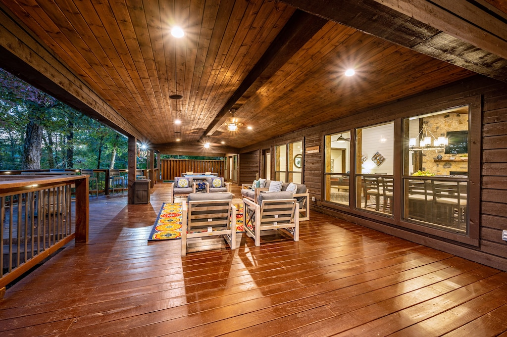 The huge patio runs the length of the cabin and has several seating areas.