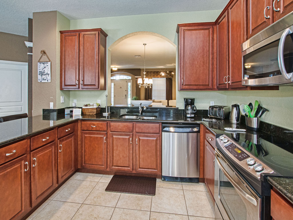 Fully equipped kitchen with a functional pass through to the dining room.