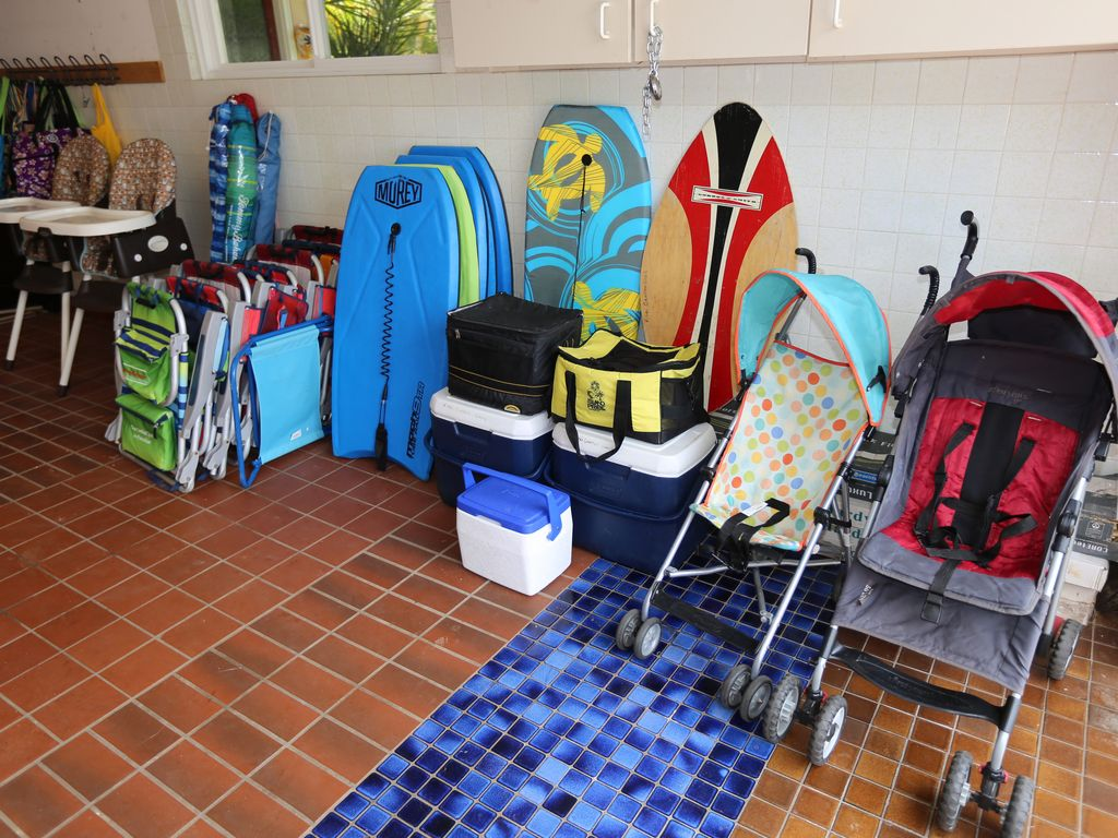 Many beach items–boogie boards, umbrellas, chairs, coolers. Strollers/highchairs