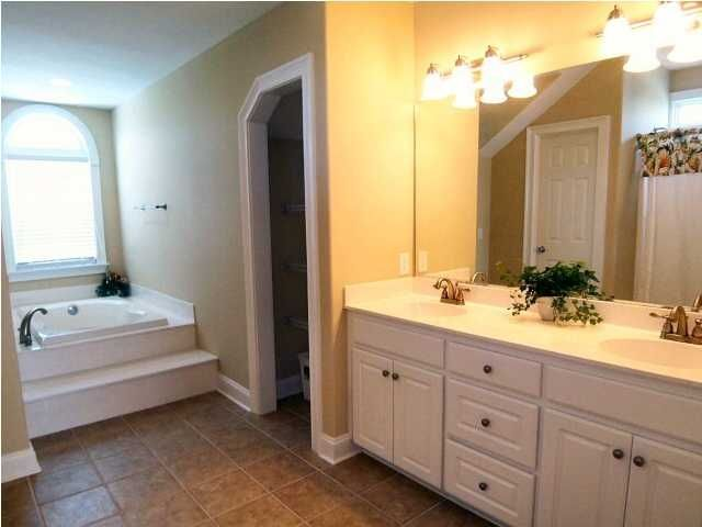 Master Bath, jetted tub and double vanity with shower as well
