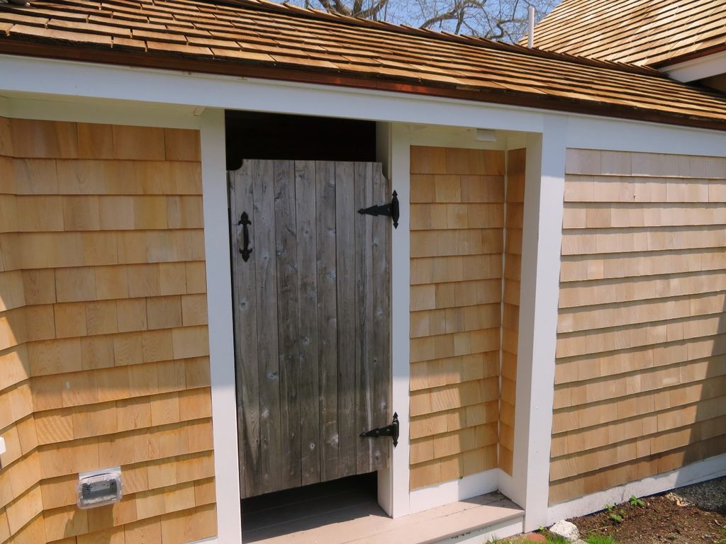 Private and roomy outdoor cedar shower located off of the rear yard patio.