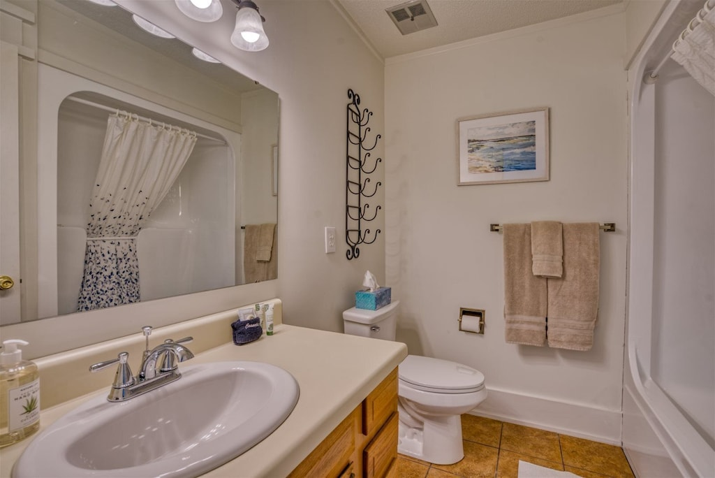 Upstairs Full bathroom with shower and tub, toilet and sink with plenty of counter space