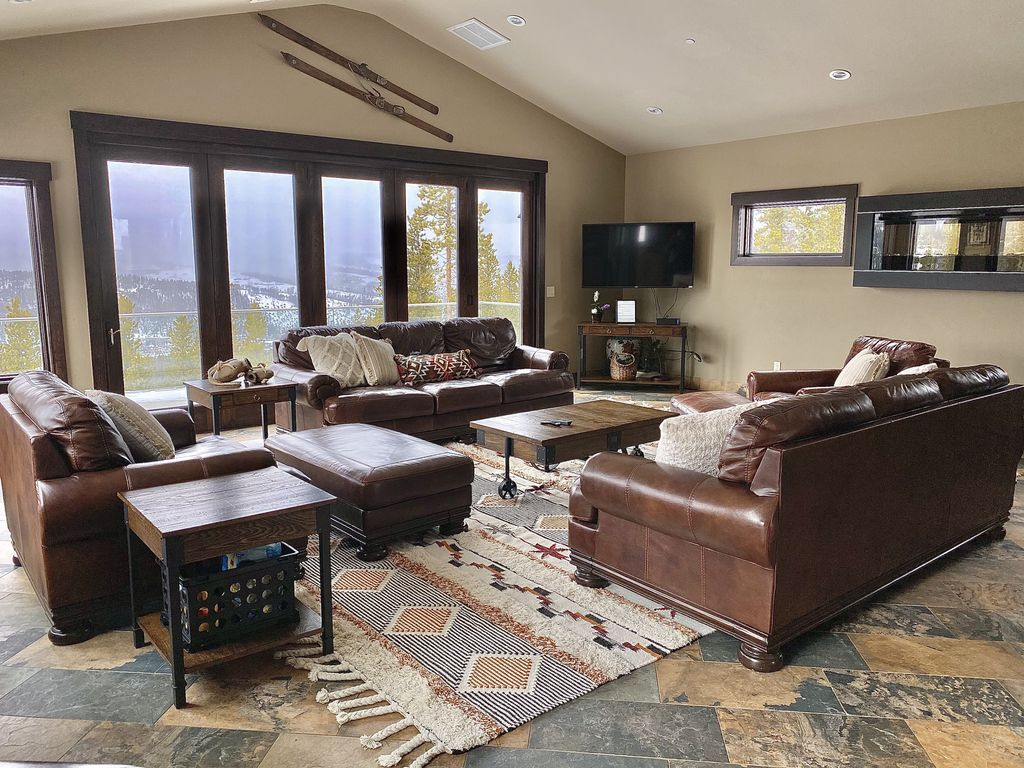 Living Room - Couches to relax on and soak in the view.  The whole door opens like an accordion.