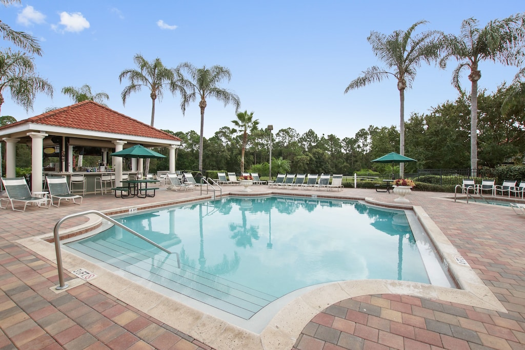 The community pool and tiki bar at the clubhouse.