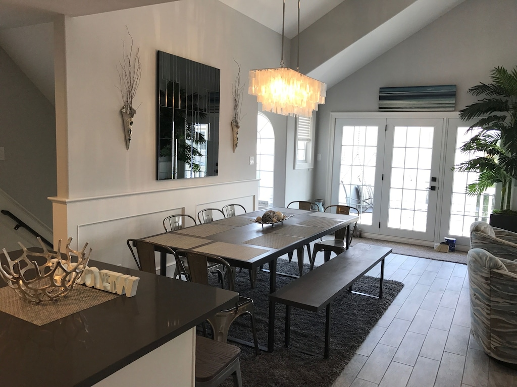 Extra large dining table comfortably seats 12 and has 3 bar stools at the island